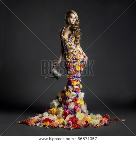 Studio portrait of blooming gorgeous lady in dress of flowers