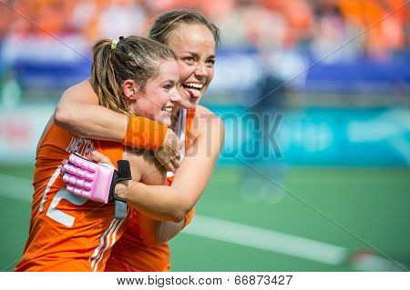 THE HAGUE, NETHERLANDS - JUNE 14: Dutch captain Maartje Paumen and Lidewij Welten hug after the final whistle at the Final match at the world championships Hockey. NED becomes World Champions in 2014