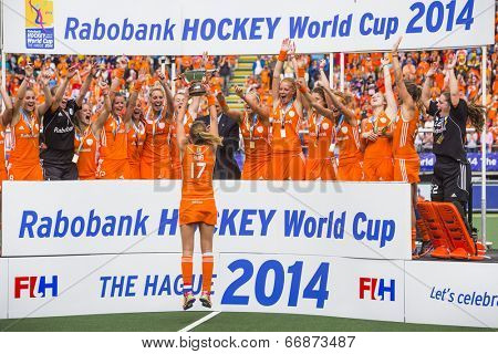 THE HAGUE, NETHERLANDS - JUNE 14, Maartje Paumen of the Dutch women field hockey squad presents the trophy to her team after winning the world championships by beating Australia 2-0 in 2014