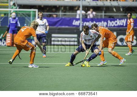 THE HAGUE, NETHERLANDS - JUNE 13: English player David Condon passes Dutch player Sander Baart during the semi-finals of the world championships hockey 2014. NED wins with 1-0