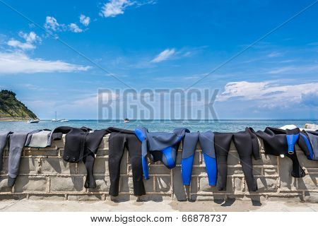 Diving Suits Drying On A Wall