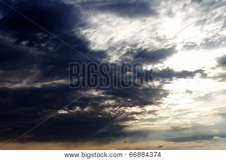 Sun On Sky And Dark Storm Clouds
