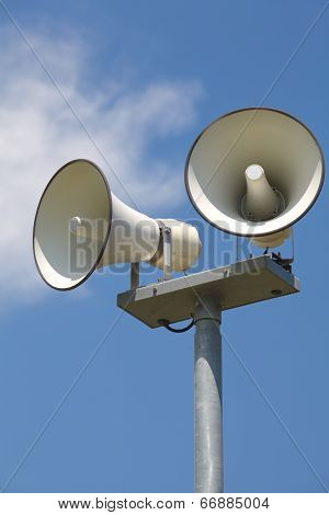 Outside loudspeaker against nice blue sky