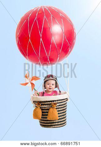 Cheerful Kid On Hot Air Balloon In The Sky