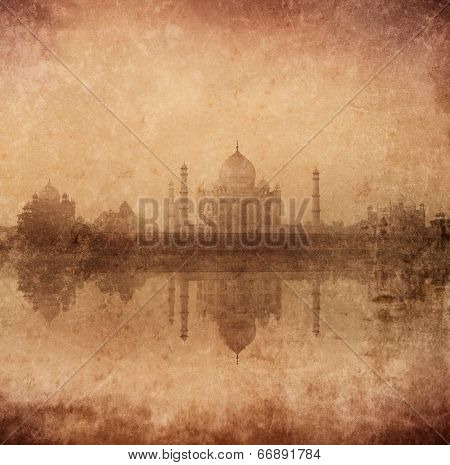 Vintage retro hipster style image of Taj Mahal with reflection in Yamuna river panorama in fog, Indian Symbol - India travel background with grunge texture overlaid. Agra, Uttar Pradesh, India