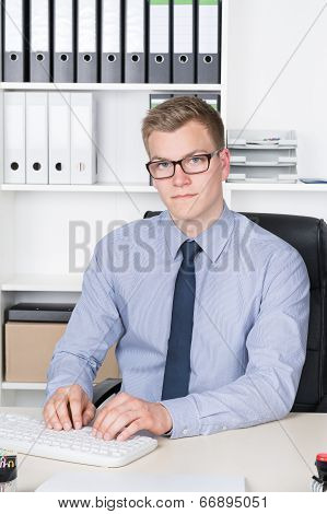 Young Businessman Is Typing At The Computer Keyboard
