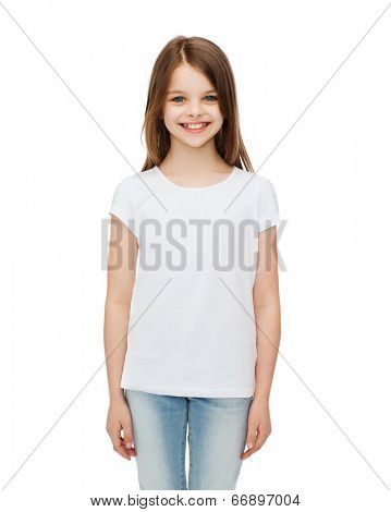 advertising and t-shirt design concept - smiling little girl in white blank t-shirt over white background