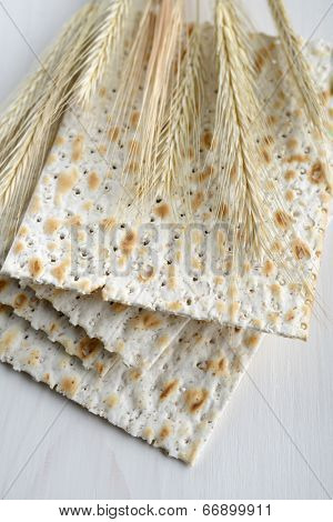 Matzo and ears on a wooden table