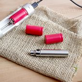 image of e-cig  - Batteries and Charger for e cigarette close up - JPG