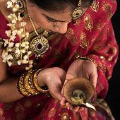 pic of sari  - Beautiful Indian female hands holding diya oil lamp - JPG