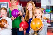 foto of health center  - Parents playing with children together at bowling center - JPG