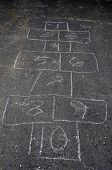 picture of hopscotch  - Hopscotch game in chalk on an asphalt driveway.