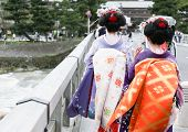 pic of geisha  - Two geisha walking on a bridge in Arashiyama Japan - JPG