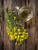 picture of cruciferous  - Rape flower on wooden table - JPG