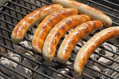 stock photo of grill  - Grilled sausage on a grill at a bbq - JPG