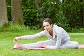 stock photo of legs air  - Woman stretching her legs on the open air - JPG