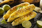 stock photo of cilantro  - Delicious Grilled Mexican Corn with Chili Cilantro and Lime - JPG