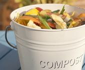 stock photo of rich soil  - Detail outdoor shot of a kitchen compost bucket - JPG
