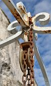 stock photo of pulley  - rusty pulley of an old well - JPG
