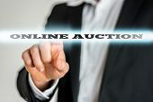 picture of ebusiness  - Closeup of businessman activating an Online auction button on virtual screen - JPG