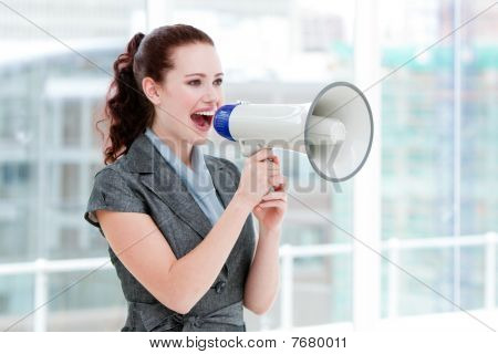 Self-assured Businesswoman Yelling Through A Megaphone