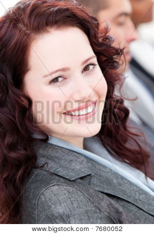 Assertive Buinesswoman Smiling At The Camera In A Meeting