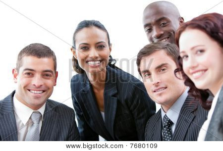 Multi-ethnic Business People Smiling At The Camera In A Meeting