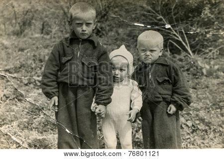 PLOTY SZCZECINSKIE, POLAND, CIRCA 1930:  Vintage photo of three little boys outdoors