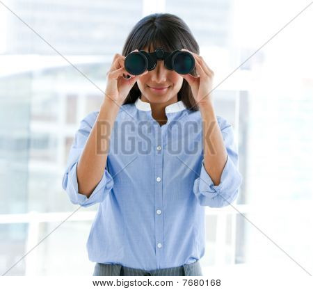 Assertive Female Executive Looking Through Binoculars