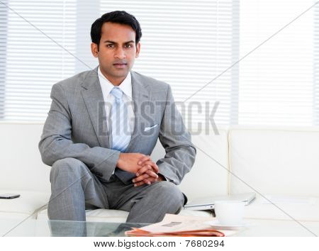 Self-assured Businessman Sitting On The Sofa