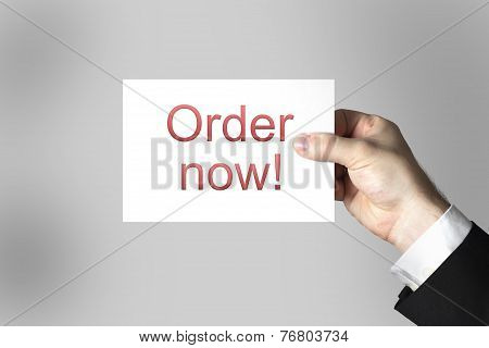 Hand Holding White Card Sign Order Now