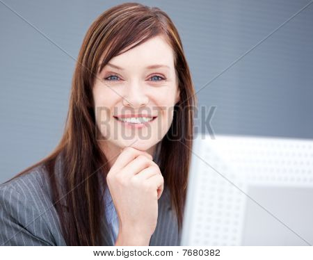 Cheerful Businesswoman Working At A Computer