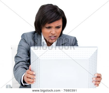 Frustrated Businesswoman Shaking Her Computer's Screen