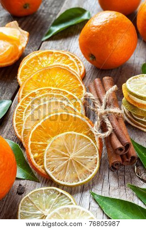 Dried Orange And Lemon Slices, Cinnamon Sticks And Ripe Tangerines On Old Table.