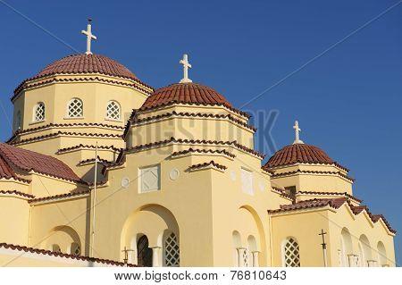 Orthodox church domes in Kamari, Santorini, Greece.