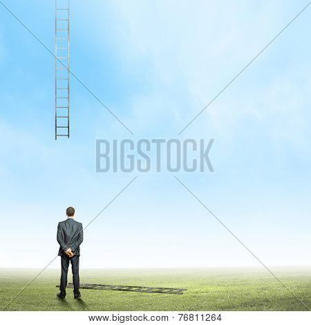 Rear view of businessman and broken ladder going up
