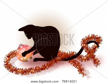 Black cat playing with a Christmas ball
