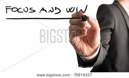 Man Writing A Business Motivational Message Focus And Win