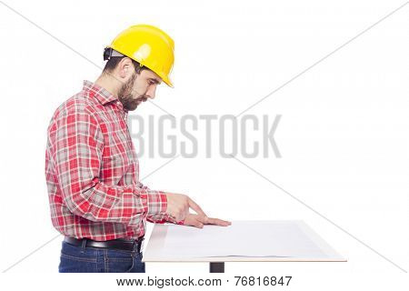 Young architect studing a plan, isolated on white background