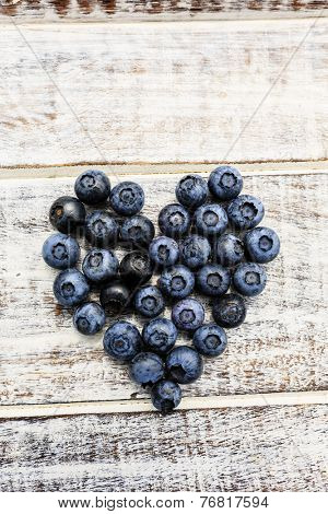 Blueberries - fresh blueberries on wooden background