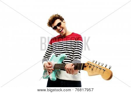 Funny fashion man playing on the guitar on a white background