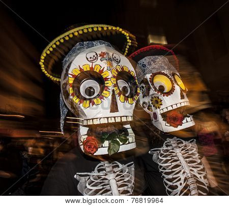 People With Large Masks In Dia De Los Muertos Procession