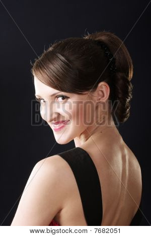 Smiling Woman In Red Dress Turns