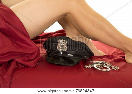 Woman Legs And Red Sheet Police Hat Below Knee Handcuffs