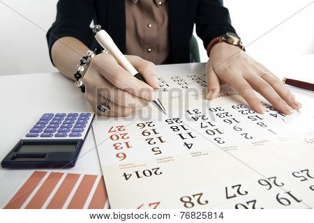 Woman Calculates Future Plans
