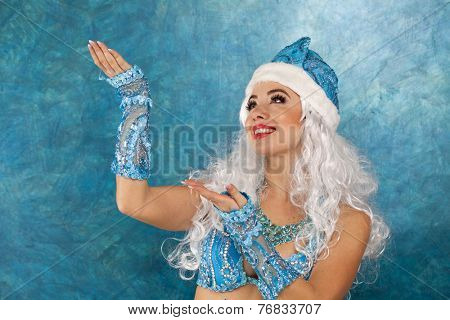 Sexy woman dressed in traditional russian christmas costume of Snegurochka (Snow Maiden), isolated on white background