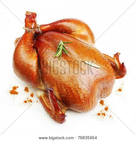 Roast chicken with rosemary spice  isolated on white background.