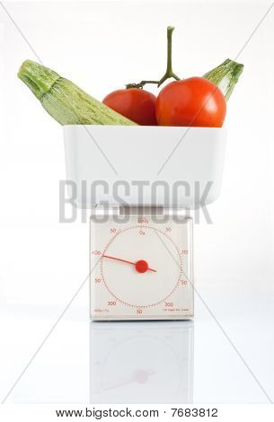 Tomatoes  And Courgettes On Balance