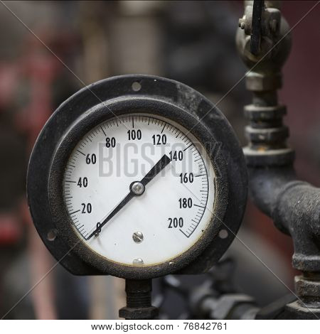Closeup Of Antique Steam Engine Pressure Gauge