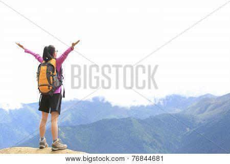 cheering hiking woman open arms on mountain peak of tibet,china